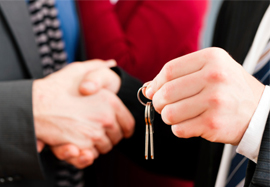 A landlord hands over keys to a new tenant at the start of their tenancy