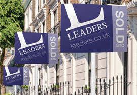 Leaders For Sale boards outside property