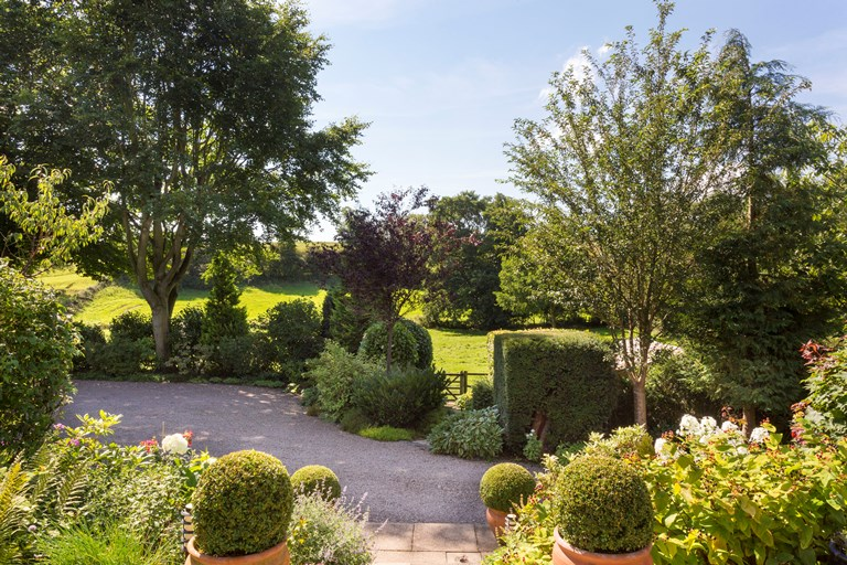 Adam bede house Ellastone garden