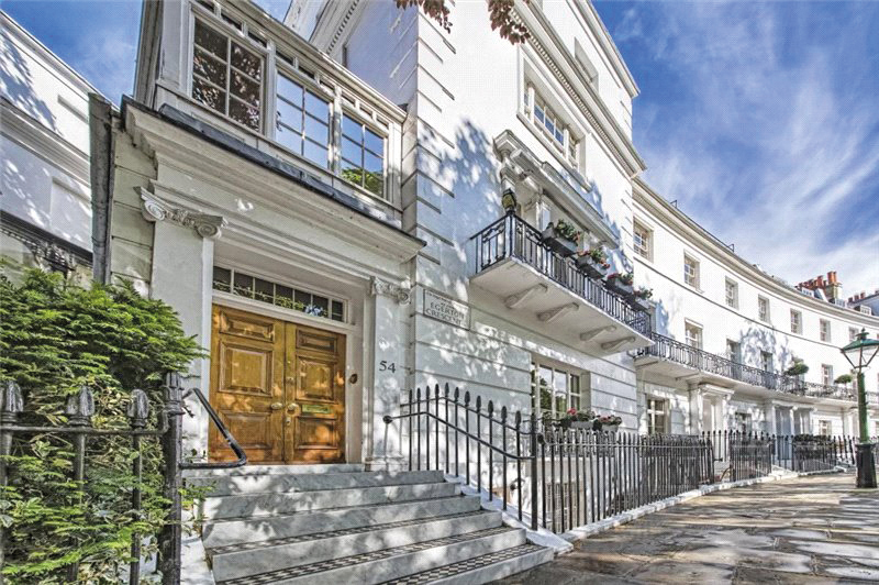Grade II listed white stucco end of terrace house in South Kensington