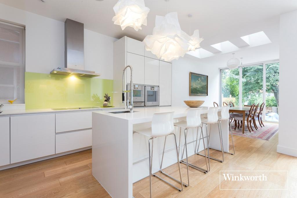 This recently refurbished house is located atop northern London in the quaint area of Golders Green